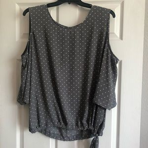 Dressy top with showy shoulder detail